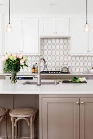 white kitchen cabinets with taupe backsplash 91203 transitional kitchen toupe kitchen cabinet marble