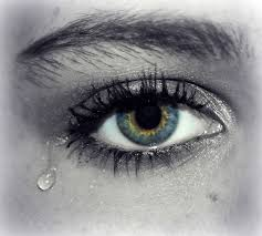 teardrop falling out of blue eye image free stock photo