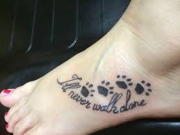 feather on foot tattoo pawprint tattoo with heart on inside of foot ankle area tattoo