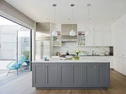 French Blue And White Ceramic Tile Backsplash Gray Island With Wooden Countertop Industrial Bar Stools 3 Black