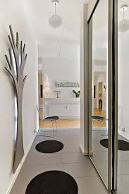 tips and tricks to enlarge a tight hallway by painting it with