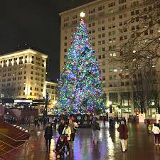 christmas night in downtown portland people gather in glow of