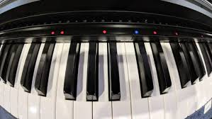 keyboard that lights up to teach you how to play this gadget turns your old piano into an educational smart piano