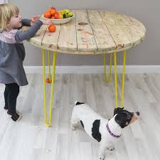 cable reel dining table with hairpin legs by frances bradley