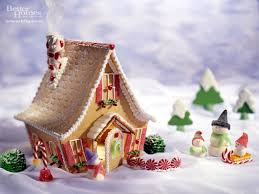gingerbread house and white picket fence with green garland and