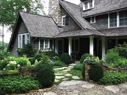 stepping stones make for a quaint cottage style entryway to this