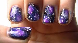 purple and black galaxy nail art