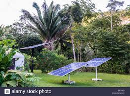 solar panels generating electricity in a backyard belize central