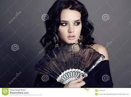 black lace fan beautiful woman with hair holding black lace fan in