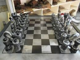 amateur mechanic builds chess set out of old car parts which one