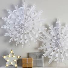 two white hanging snowflake decorations by
