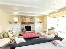 stone fireplace surround traditional cellular shades family room