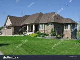 Rambler House by One Story Rambler House Suburban Neighborhood Stock Photo 80743843
