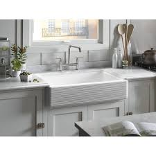 tips kohler sink design with glass windows and white painted wall