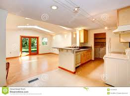 empty house interior with open floor plan living room and kitch