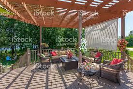 spacious backyard patio deck with pergola stock photo 479830824