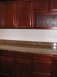 dark brown color staining oak kitchen cabinets with marble