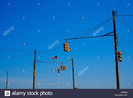 Flag Lights Traffic Lights And An American Flag At A Road Intersection In