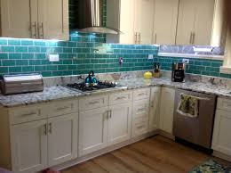 interior interior blue tile kitchen backsplash and white marble