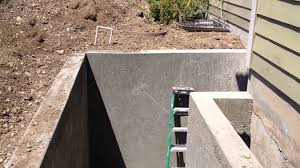 basement entrance door construction retaining wall enclosure