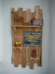 how to make a decorative hanging shelf from pallets slideshow the how to make a decorative hanging shelf from pallets slideshow the diy magician youtube