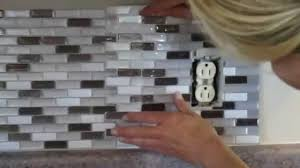 how to cut peel and stick smart tiles around an electrical outlet