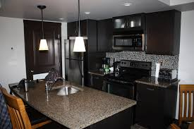 gray black small stone back splash with black wooden cabinet gray black small stone back splash with black wooden cabinet combined with rectangle kitchen island with