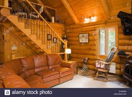log living room furniture living room stairs leading to the upstairs master bedroom inside a