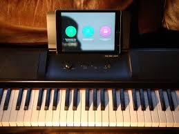 keyboard that lights up to teach you how to play review the one light smart keyboard teaches you piano