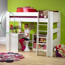white wooden study table under white wooden bunk bed on cream
