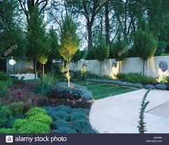 the sanctuary garden chelsea 2002 lit up at night designer