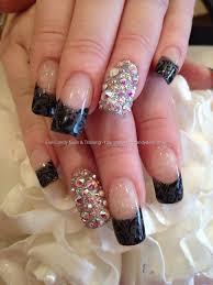 grey polish tips with black freehand nail art and swarovski ring