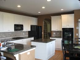kitchen ideas with cream cabinet and wall also black countertop