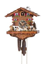 hones chalet style one day cuckoo clock cottage with man sawing wood
