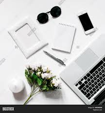 Office Desk Plant by White Office Desk With Laptop Smartphone Office Plant And