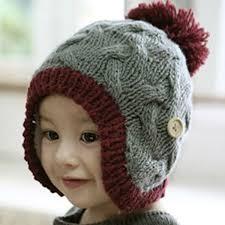 modelos modernos para gorras tejidas con bonitos gorros para recien nacidos tejidos de lana imágenes de
