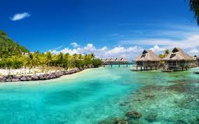 paradise palm trees beaches clouds lagoon shallow bungalows hilton