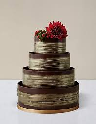 chocolate wedding cakes shimmering hoop chocolate wedding cake gold m s