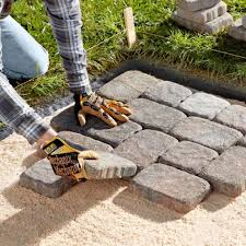 Laying Patio Slabs Extending Your Concrete Patio With Pavers Dengarden