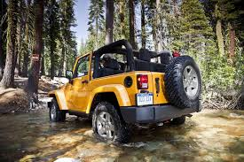 crashed jeep wrangler fiat chrysler recalls more than half a million jeep wranglers for