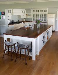 the kitchen island can add volumes of elegance to a traditional