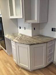 backsplash to go with brown fantasy quartzite countertop