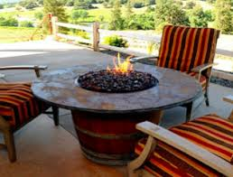 wine barrel fire table vin de flame the reserve wine barrel fire pit table with 42 slate