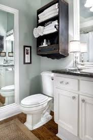 white wood panelling to make light blue bathroom more airy home