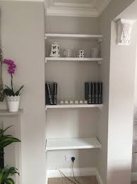 natural wall color with chic wall shelving units using for