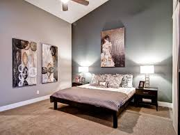 bedroom black wood platform bed white bedside lamps white