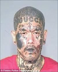 heavily tattooed gang member with u0027gucci u0027 inked on his forehead is