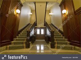 interior architecture double staircase in foyer stock picture