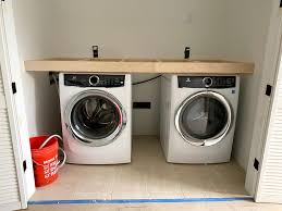 how to install base cabinets in laundry room how to maximize your laundry room with new counters the