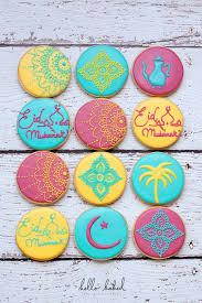an arabic tea pot palm trees eid mubarak a greeting meaning